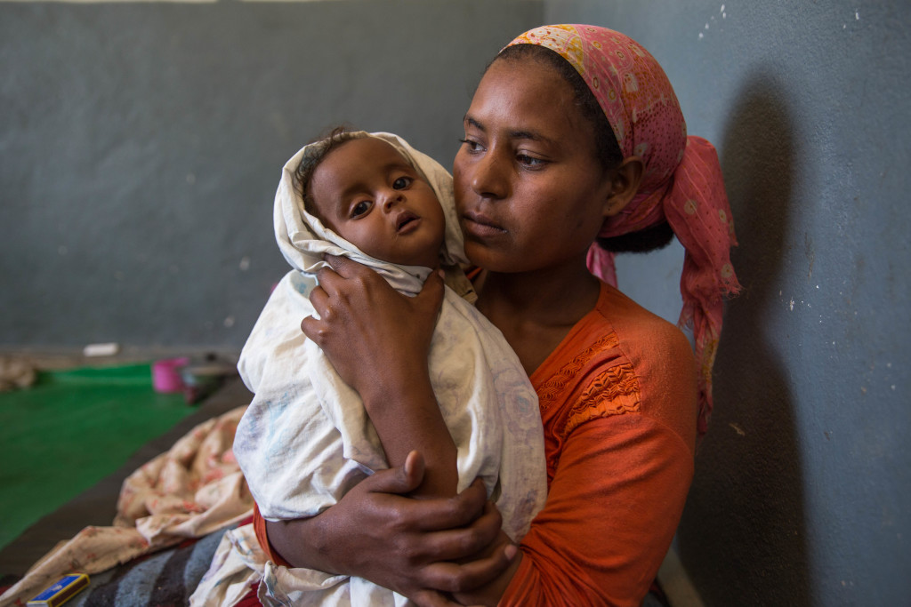 "Mother rushed her only babies – seven month old twins – to the health centre eight days ago, ""I brought my babies as one of them refused to breastfeed and then became very floppy and wasn't breathing properly. I was afraid he would die he was so small."" Hawal was around 3.5 kilos when he arrived and now is receiving a special therapeutic milk that Unicef provides to health centres and hospitals in Ethiopia for severely acutely malnourished children. – around 3.5 kilos"" now getting special type of therapeutic milk. Hawal's mother says she is in no doubt that the milk has saved her son's life. She says she has a lot of problems. Worry is etched into her young face, ""nursing twins has not been easy at the best of times but with no rain and no harvest things are desperate."" Her husband has had to go to Addis in search of work. She says they planted maize, wheat and chillis last year but only harvested half of what they expected to. Doctors at the health centre are worried that cases of severe acute malnutrition will increase in the next couple of months. They say that malnutrition screening is happening at the community level but it's vital to make sure that all children and their families can eat. It is imperative therefore that supplementary feeding programmes – led by the UN World Food Programme (WFP) – continue and are scaled up to ensure that moderately malnourished children (and their families) are receiving food when stocks are low or non-existent in homes. Without focus on supplementary feeding, we will start to see more children becoming severely acutely malnourished children, requiring more attention at health centres and hospitals as opposed to at the community level – and of course more funds. Ilala Health Centre, Shalla Woreda, West Arsi Zone. © UNICEF Ethiopia/2016/Ayene"